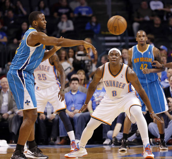 Oklahoma City Thunder's Ronnie Brewer (8) defends on New Orleans Hornets' Darius Miller (2) during the NBA basketball game between the Oklahoma City Thunder and the New Orleans Hornets at the Chesapeake Energy Arena on Wednesday, Feb. 27, 2013, in Oklahoma City, Okla. Photo by Chris Landsberger, The Oklahoman