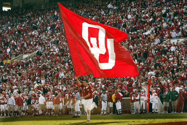 The OU flag is carried accross the field after a touchdown during the second half of the college football game between The University of Oklahoma Sooners (OU) and the Baylor Bears at the Gaylord Family-Oklahoma Memeorial Stadium on Saturday, Oct. 10, 2009, in Norman, Okla.   Photo by Steve Sisney, The Oklahoman.