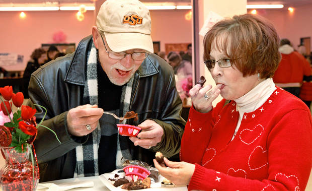Terry and Sharri Reeves of Yukon taste the chocolates they selected from display tables.  More than 400 visitors satisfied their collective sweet tooth by sampling confections and treats created and displayed by more than 20 vendors at Yukon's Chocolate Festival First Annual Affair Extraordinaire  in the Dale Robertson Activity Center on Saturday, Feb. 11, 2012, Photo by Jim Beckel, The Oklahoman