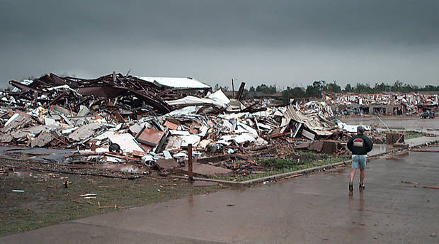 May 3, 1999, Oklahoma City Tornado:  Tornado damage: Emerald Springs Apartments, 12500 S Western in Moore across from Westmoore High School,  Apts completely gone as a man runs past looking for survivors.  Staff Photo by Paul B. Southerland