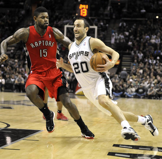 San Antonio Spurs guard Manu Ginobili, right, of Argentina, drives against Toronto Raptors forward Amir Johnson during the first half of an NBA basketball game on Wednesday, Dec. 26, 2012, in San Antonio. (AP Photo/Bahram Mark Sobhani)