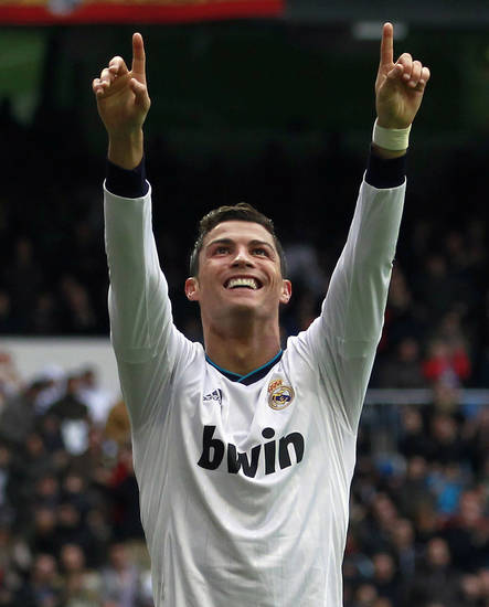 Real Madrid's Cristiano Ronaldo from Portugal celebrates his goal during a Spanish La Liga soccer match against Getafe at the Santiago Bernabeu stadium in Madrid, Spain, Sunday, Jan. 27, 2013. (AP Photo/Andres Kudacki)