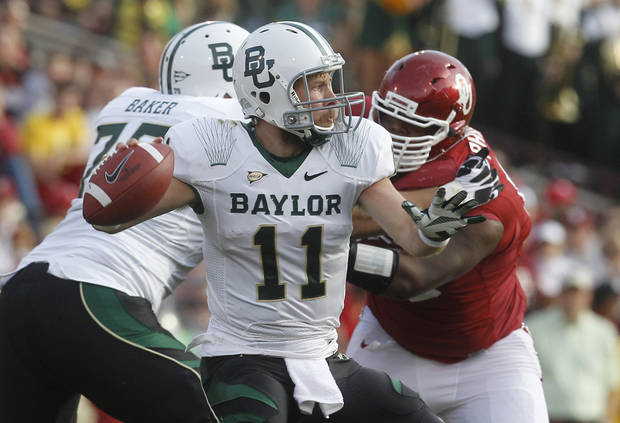 Baylor quarterback Nick Florence (11) passes against Oklahoma in the second quarter of an NCAA college football game in Norman, Okla., Saturday, Nov. 10, 2012. (AP Photo/Sue Ogrocki)