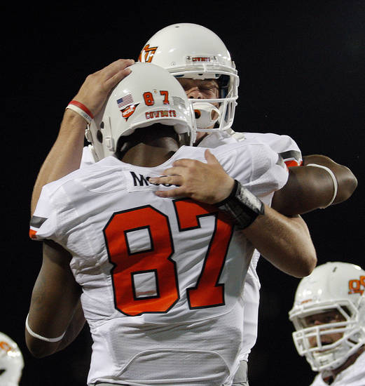 Oklahoma State&#039;s Wes Lunt (11) celebrates a touchdown with Tracy Moore (87) during the college football game between the University  of Arizona and Oklahoma State University at Arizona Stadium in Tucson, Ariz.,  Saturday, Sept. 8, 2012. Photo by Sarah Phipps, The Oklahoman