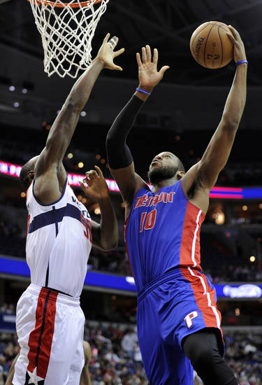 Detroit Pistons center Greg Monroe (10) goes to the basket against Washington Wizards center Emeka Okafor (50) during the first half of an NBA basketball game, Saturday, Dec. 22, 2012, in Washington. (AP Photo/Nick Wass)