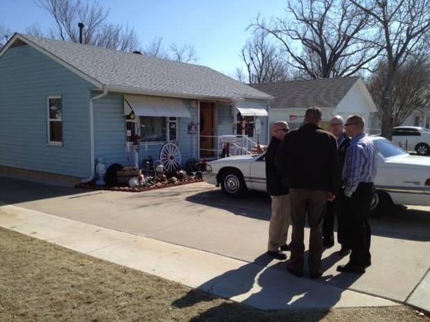 Investigators assemble outside 619 Villa in Norman where firemen called to a fire at 11:00 am found a single person dead from thermal burns. Photo by Steve Sisney