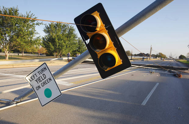 Street signals and power lines down along Rockwell Ave. at NW 128 Street, the entrance to Francis Tuttle Vo Tech, in Oklahoma City Tuesday, Aug. 9, 2011. A thunderstorm moved through the area Monday evening causing storm damage. Photo by Paul B. Southerland, The Oklahoman
