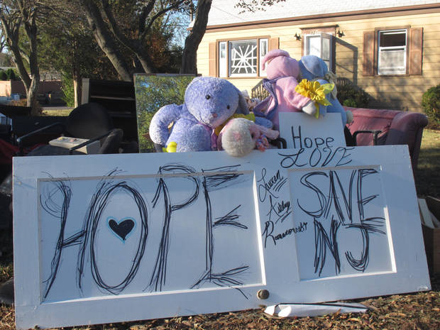 In this Sunday, Nov. 4, 2012 photo. residents of a flood-gutted home in Point Pleasant N.J., haven't given up hope for the Jersey shore, which was pummeled by Superstorm Sandy. A new storm due Wednesday was raising fears about new flooding and damage along the shore. (AP Photo/Wayne Parry)