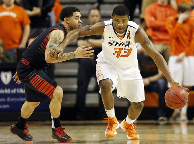 Oklahoma State's Marcus Smart (33) drives the ball on a fast break against Texas Tech's Josh Gray (5) during a men's college basketball game between Oklahoma State University and Texas Tech at Gallagher-Iba Arena in Stillwater, Okla., Saturday, Jan. 19, 2013. OSU won, 79-45. Photo by Nate Billings, The Oklahoman