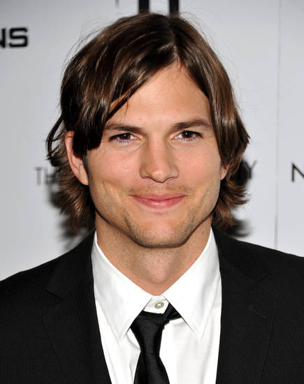 "FILE - In this Jan. 20, 2011 file photo, actor Ashton Kutcher attends a special screening of ""No Strings Attached"" in New York. Kutcher is giving his Twitter followers a clue that he may be joining ""Two and a Half Men"" ó or he's punking them. A tweet Wednesday came amid reports that he's nearing a deal to replace the fired Charlie Sheen on TV's top-rated comedy. (AP Photo/Evan Agostini, File) ORG XMIT: NY115"