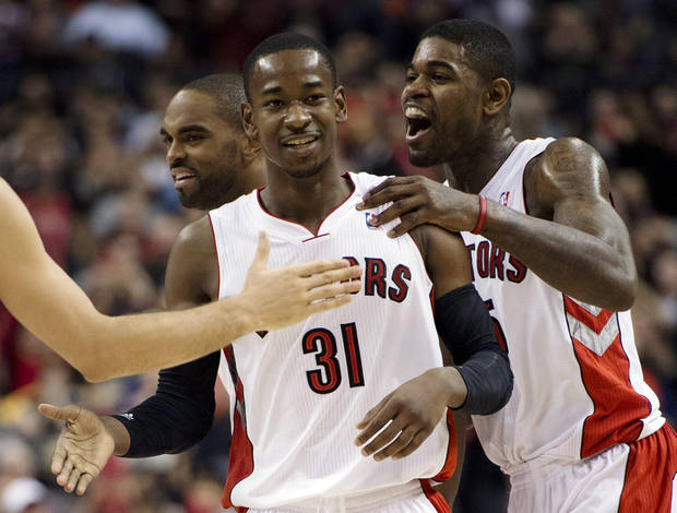 Toronto Raptors guard Terrence Ross (31) is congratulated by Amir Johnson, right, and Alan Anderson, left, after making a buzzer-beating 3-pointer against the Portland Trail Blazers at the end of the first half of an NBA basketball game in Toronto, Wednesday, Jan. 2, 2013. (AP Photo/The Canadian Press, Frank Gunn) ORG XMIT: FNG103