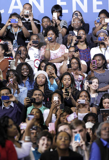 Students from Prince George's County Community College uses uses their PDA's as President Barack Obama speaks about energy, Thursday, March, 15, 2012, in Largo, Md. (AP Photo/Pablo Martinez Monsivais)