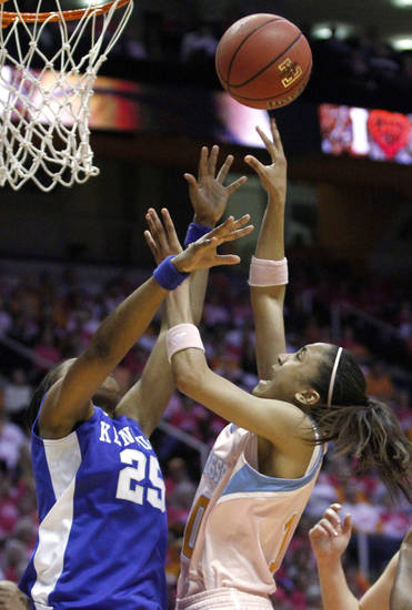 Tennessee's Meighan Simmons, right, shoots over Kentucky's Bra'Shey Ali (25) in the second half of an NCAA college basketball game on Monday, Feb. 13, 2012, in Knoxville, Tenn. Tennessee won 91-54. (AP Photo/Wade Payne)