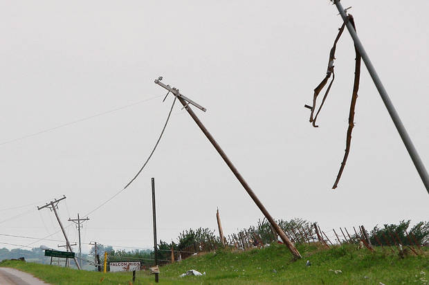 A tornado pulled down power lines and twisted tall utility poles on SH 74 near Cashion Tuesday afternoon,  May 24, 2011,   Photo by Jim Beckel, The Oklahoman