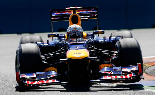 Red Bull Racing Team Formula One driver Sebastian Vettel from Germany steers his car during the third free practice session at Valencia street circuit, Spain, Saturday, June 23, 2012. The race European Formula One Grand Prix will take place on Sunday over the street circuit surrounding the city's port. (AP Photo/Fernando Hernandez)