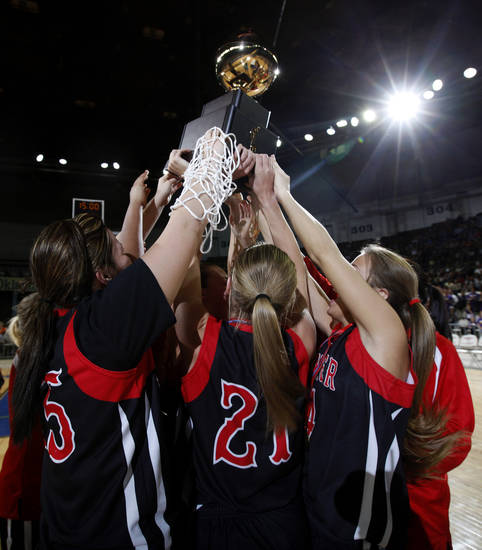 Frontier celebrates their state championship over Okarche in the girls Class A state basketball tournament between Okarche and Frontier  at the State Fair Arena in Oklahoma City,  Saturday, March 3, 2012. Photo by Sarah Phipps, The Oklahoman