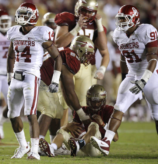 Oklahoma's Aaron Colvin (14) celebrates beside R.J. Washington (91) after sacking Florida's Clint Trickett (9) during a college football game between the University of Oklahoma (OU) and Florida State (FSU) at Doak Campbell Stadium in Tallahassee, Fla., Saturday, Sept. 17, 2011. Photo by Bryan Terry, The Oklahoman