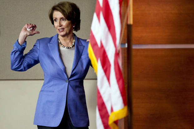 House Minority Leader Nancy Pelosi, D-Calif., turns to answer a reporter as she exits a news conference after speaking about the fiscal cliff on Capitol Hill, in Washington, Wednesday, Dec. 19, 2012. (AP Photo/Jacquelyn Martin)