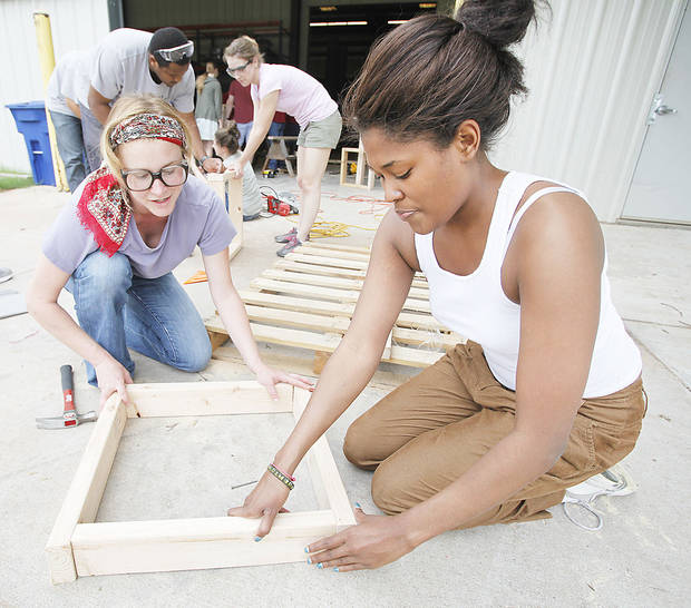 Christine Benner, left, and Ashley Rhone build a concrete form in the University of Oklahoma�s WaTER Center field methods course Monday in Norman. Photos By Steve Gooch, The Oklahoman
