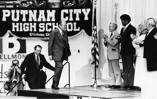 President Gerald Ford, with Oklahoma U.S. Senator Henry Bellmon right behind him, reaches the stage at Putnam City High School during a Tuesday, 10/22/74, visit to Oklahoma City. Staff photo by Dick Swoboda taken 10/22/74.