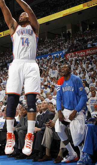 Oklahoma City's Kevin Durant (35) cheers as Daequan Cook (14) shoots a three-point shot during Game 2 of the first round in the NBA basketball playoffs between the Oklahoma City Thunder and the Dallas Mavericks at Chesapeake Energy Arena in Oklahoma City, Monday, April 30, 2012. Photo by Sarah Phipps, The Oklahoman