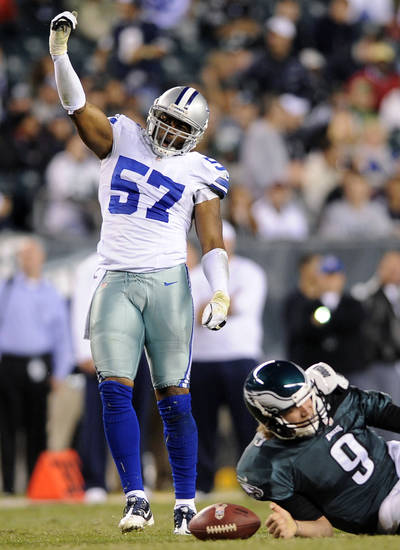 Dallas Cowboys outside linebacker Victor Butler, left, reacts after sacking Philadelphia Eagles quarterback Nick Foles in the second half of an NFL football game, Sunday, Nov. 11, 2012, in Philadelphia. Dallas won 38-23. (AP Photo/Michael Perez)