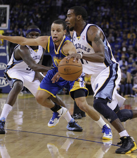 Memphis Grizzlies' Mike Conley, right, drives against Golden State Warriors' Stephen Curry during the first half of an NBA basketball game Friday, Nov. 2, 2012, in Oakland, Calif. (AP Photo/Ben Margot)