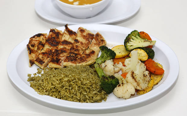 Chicken with vegetables and rice at Green and Grilled in Oklahoma City. Photo By Steve Gooch, The Oklahoman <strong>Steve Gooch - The Oklahoman</strong>