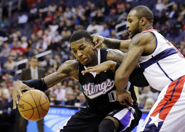 Sacramento Kings forward Thomas Robinson (0) works against Washington Wizards forward Trevor Booker (35) in the first half of an NBA basketball game, Monday, Jan. 28, 2013, in Washington. (AP Photo/Alex Brandon)