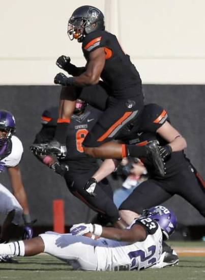 OSU's all-black uniform combo, featuring the gray Phantom Pistol Pete on the black helmet, worn against TCU.