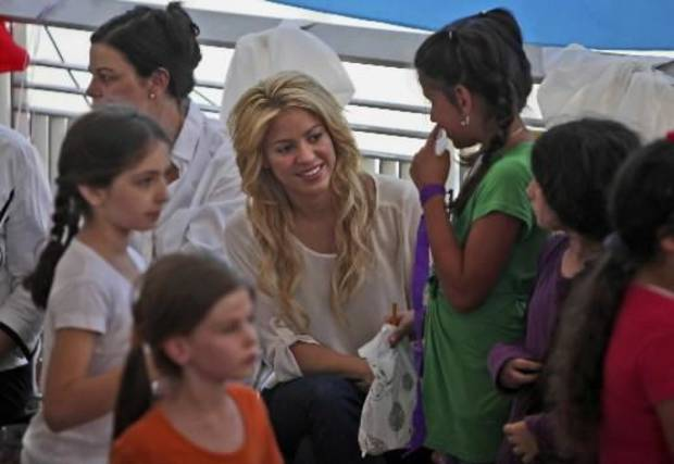 Colombian singer Shakira, center, visits a school in Jerusalem, Tuesday, June 21, 2011. Shakira is attending the Presidential Conference, sponsored by Israeli President Shimon Peres and will take part in panel alongside comedian Sarah Silverman.