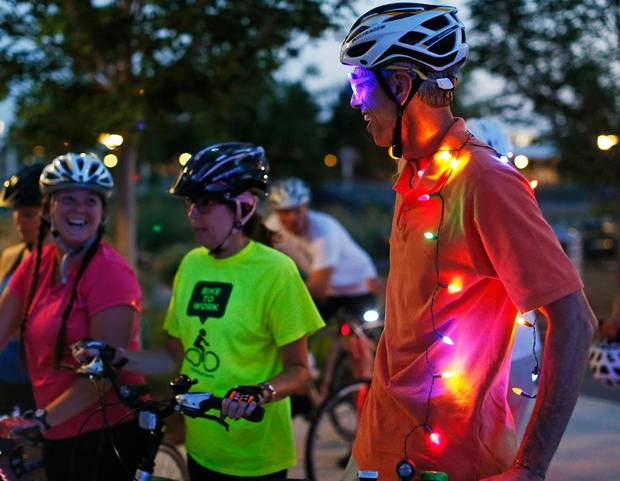 Mike O'Meara, of Edmond, Okla., right, talks with other cyclists before the Full Moon Bicycle Ride organized by the Myriad Gardens and Schlegel Bicycles in Oklahoma City, Monday, July 22, 2013. Photo by Nate Billings, The Oklahoman