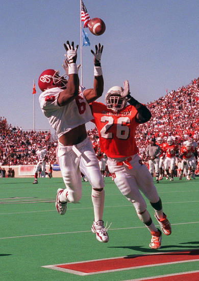 OU's Michael McDaniel makes a touchdown catch from Eric Moore (in background) as OSU's Jitu Criddle defends during the Bedlam college football game on Nov. 9, 1996. Photo by Doug Hoke, The Oklahoman