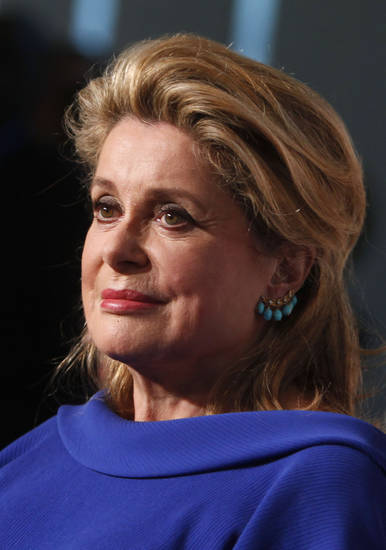   French actress Catherine Deneuve arrives for the Film Society of Lincoln Center&#039;s 39th annual Chaplin Award Gala at Alice Tully Hall, Monday, April 2, 2012 in New York. (AP Photo/Jason DeCrow)  