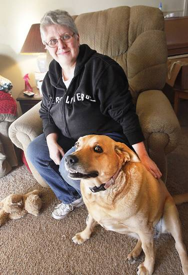 Denene Harper is with one of her service dogs, Lady, at her home in Corn. Harper is working to change state law passed so that people who are training their own service dogs can bring the canines into stores and businesses.  Photo By David McDaniel, The Oklahoman