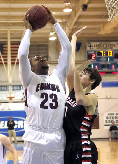 Edmond Memorial's Shaquille Morris shoots over Mustang's Colton Haddock during the boys high school basketball game between Mustang and Edmond Memorial at the Bruce Gray Invitational at Deer Creek High School, Friday,July 26, 2013.Photo by Sarah Phipps, The Oklahoman