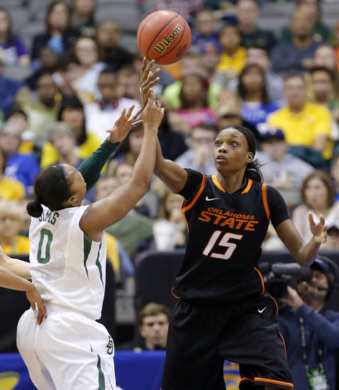 Oklahoma State's Toni Young (15) fights for the ball with Baylor's Odyssey Sims (0) during the Big 12 tournament women's college basketball game between Oklahoma State University and Baylor at American Airlines Arena in Dallas, Sunday, March 10, 2012.  Oklahoma State lost 77-69. Photo by Bryan Terry, The Oklahoman