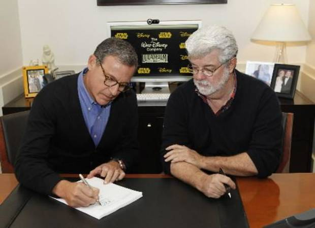 This image released by ABC shows Disney President and CEO Robert Iger, left, and filmmaker George Lucas of LucasFilm Ltd. at a contract signing in Burbank, Calif., Tuesday, Oct. 30, 2012. The Walt Disney Co. announced Tuesday that it was buying Lucasfilm Ltd. for $4.05 billion. (AP)