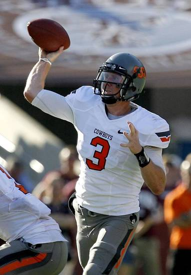 Oklahoma State's Brandon Weeden (3) throws a pass in the second half on Saturday. Photo by Sarah Phipps, The Oklahoman