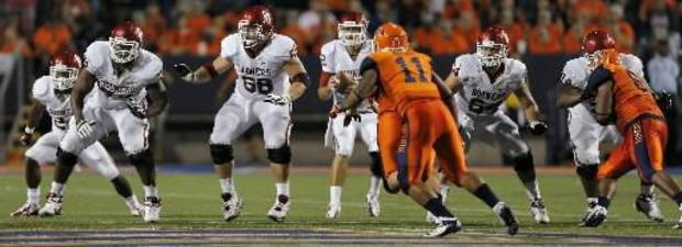 The Sooners' offensive line goes to work against the UTEP defense during the college football game between the University of Oklahoma Sooners (OU) and the University of Texas El Paso Miners (UTEP) at Sun Bowl Stadium on Sunday, Sept. 2, 2012, in El Paso, Texas. Photo by Chris Landsberger, The Oklahoman