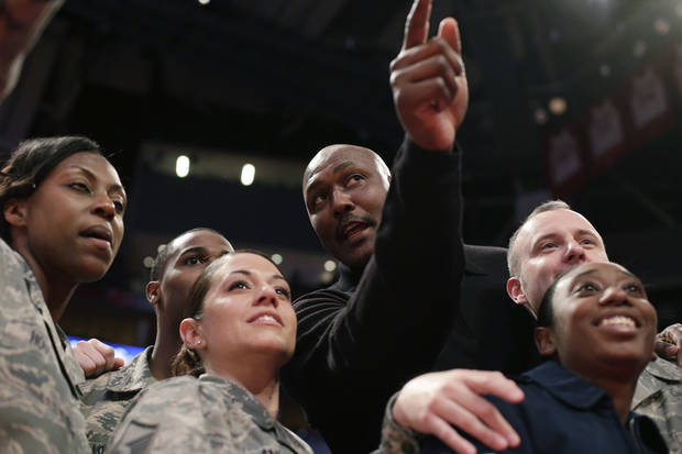 Former NBA player Karl Malone talks with members of the Air Force during the second half of the Rising Stars Challenge basketball game at NBA All-Star Weekend, Friday, Feb. 15, 2013, in Houston. (AP Photo/Eric Gay)