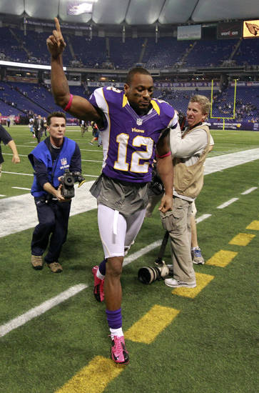 Minnesota Vikings wide receiver Percy Harvin (12) runs off the field after an NFL football game against the Tennessee Titans, Sunday, Oct. 7, 2012, in Minneapolis. The Vikings won 30-7. (AP Photo/Genevieve Ross)