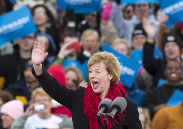 Wisconsin Republican Senate candidate, Rep. Tammy Baldwin, D-Wis., waves to the crowd before a campaign stop by President Barack Obama at Austin Straubel International Airport in Green Bay, Wis.,Thursday, Nov. 1, 2012. (AP Photo/Tom Lynn)