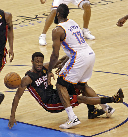 Oklahoma City's James Harden (13) and Miami's Norris Cole (30) collide during Game 2 of the NBA Finals between the Oklahoma City Thunder and the Miami Heat at Chesapeake Energy Arena in Oklahoma City, Thursday, June 14, 2012. Photo by Chris Landsberger, The Oklahoman