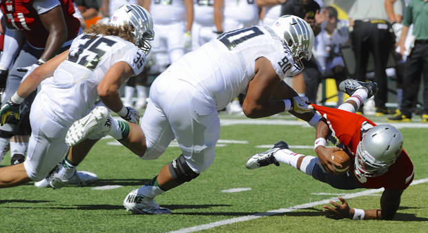 Oregon's Rickyt Havili-Heimuli (90) tackles Nicholls State's Kalen Henderson (19) during the first half of an NCAA college football game in Eugene, Ore., Saturday, Aug. 31, 2013. (AP Photo/Greg Wahl-Stephens)