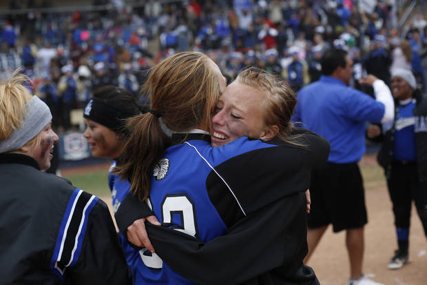Little Axe's Aspen Vail (5) hugs Ally Allen (23) after winning the 3A OSSAA Championship softball game between against Sequoyah at ASA Hall of Fame Stadium in Oklahoma City, Saturday, Oct. 6, 2012.  Photo by Garett Fisbeck, The Oklahoman