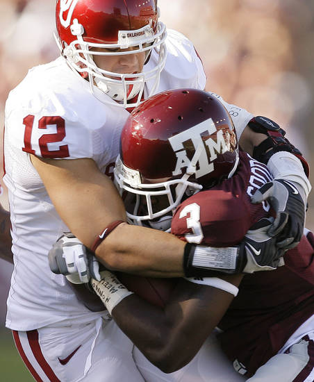 OU's Austin Box tackles Mike Goodson of Texas A&M during the college football game between the University of Oklahoma and Texas A&M University at Kyle Field in College Station, Texas, Saturday, November 8, 2008.  BY BRYAN TERRY, THE OKLAHOMAN