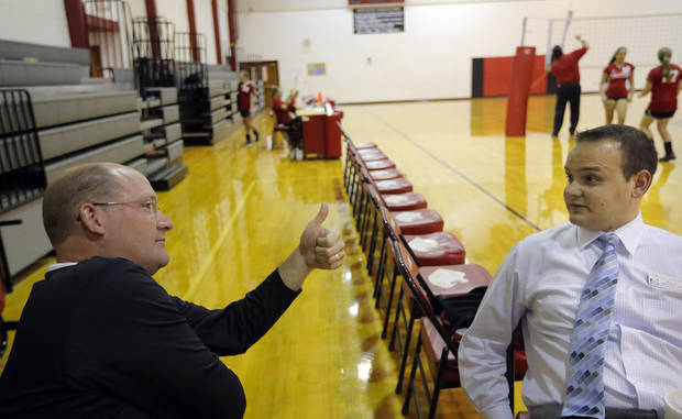 Edmond Public Schools' Athletic Director Mike Nunley talks with Cimarron Middle School principal Cordell Ehrich at a volleyball match, Thursday, Sept. 13, 2012. Photo by Sarah Phipps, The Oklahoman