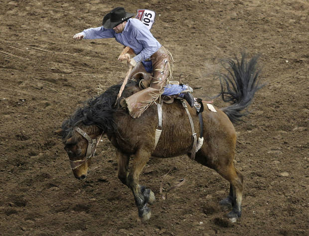 Keith Brauer, of Freeburg, Illinois, competes in Saddle Bronc during the final performance of International Finals Rodeo at the State Fair Arena in Oklahoma City, Okla., Sunday, Jan. 20, 2013.  Photo by Garett Fisbeck, For The Oklahoman