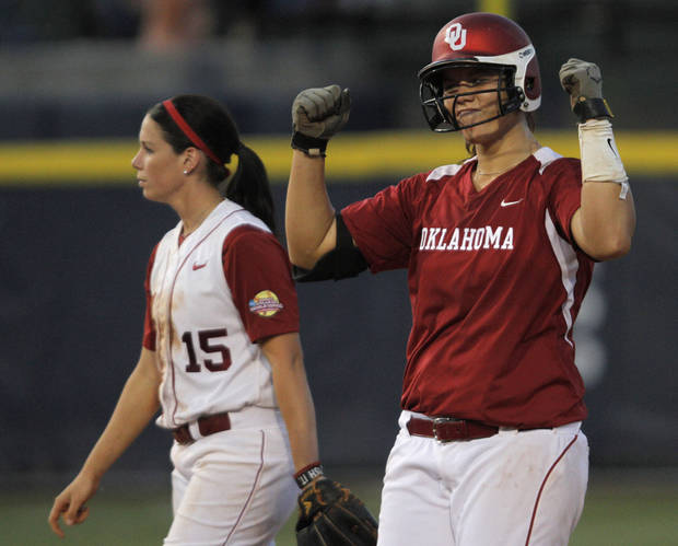 Oklahoma's Keilani Ricketts (10) celebrates as Alabama's Danae Hays (15) walks away during a Women's College World Series game between OU and Alabama at ASA Hall of Fame Stadium in Oklahoma City, Monday, June 4, 2012.  Photo by Garett Fisbeck, The Oklahoman